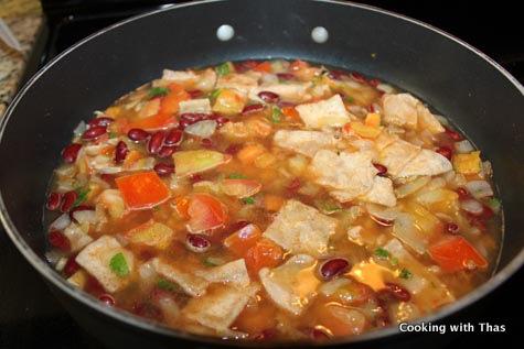 making-tortilla chicken soup