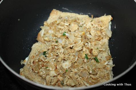 layering chicken on bread
