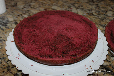 red velvet cake cut into halves