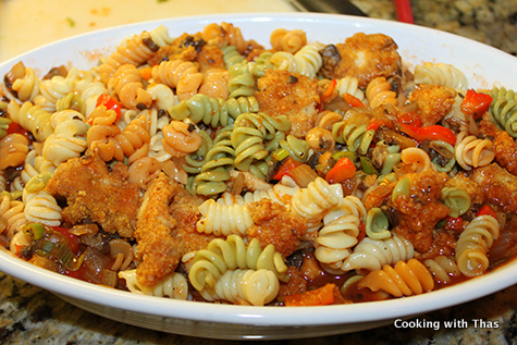 crusted chicken mixed with sauce and pasta