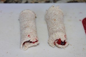 bread spread with jam and rolled up