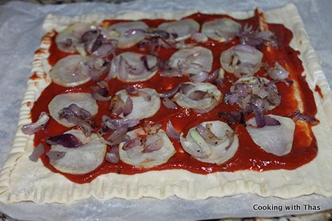 puff pastry sheet topped with potato