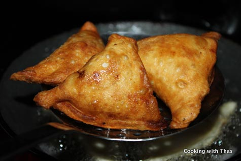 frying chicken samosa