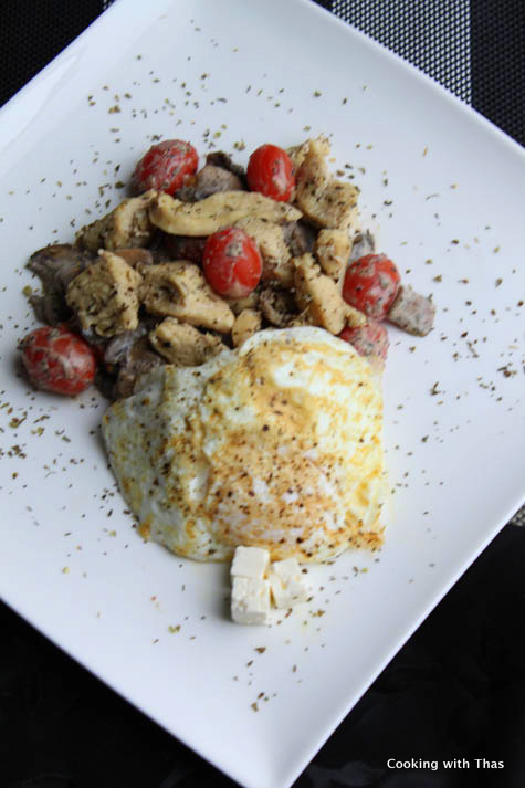 herb chicken with over easy egg