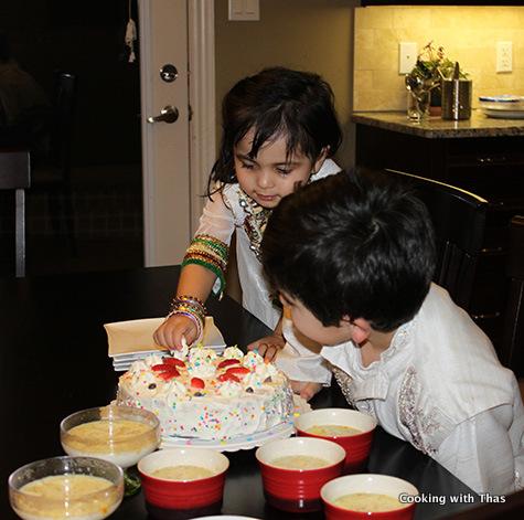kids enjoying the cake