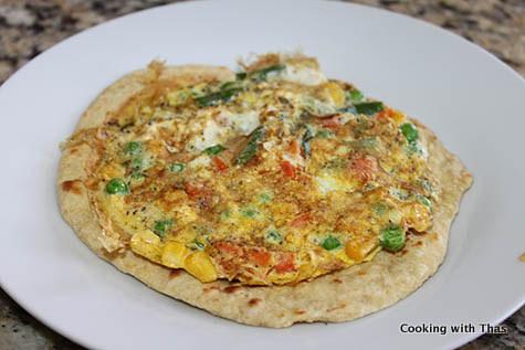 making chapati and egg rolls