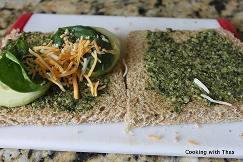 making pesto cucumber sandwich